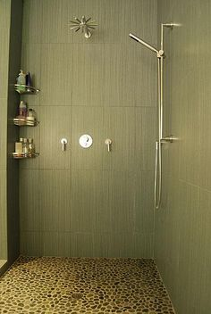 shower with pebble floor and two spouts, no more would my man have to cower in the back without h2o