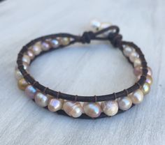 A personal favorite from my Etsy shop https://www.etsy.com/listing/268070811/leather-freshwater-pearl-bracelet-pearls