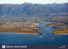 Download this stock image: The Buller River dredge at work on a sunny day in Westport, New Zealand - EHEFM8 from Alamy's library of millions of high resolution stock photos, illustrations and vectors.