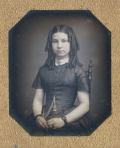 Daguerreotype of beautiful young lady with coiled tresses, a gorgeous dress & jewelry. (via Dennis A. Waters Fine Daguerreotypes)