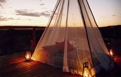 What a romantic idea ~ mosquito tent and great lighting. Just add champagne!