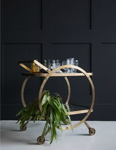 Circular Brass And Glass Drinks Trolley. Ideal for entertaining, our Circular Brass & Glass Drinks Trolley is a show-stopping piece of furniture for your home. Vintage Drinks Trolley, Retro Side Table, Drinks Tray, Beverages, Mad About The House, Artwork For Home, Small Bars, Bar Furniture, Elegant Homes