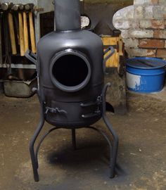 Wood / charcoal burner. Made from an old propane tank.
