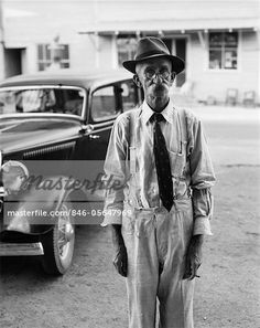 1930s PORTRAIT OF OLD MAN WEARING HAT GLASSES TIE & SUSPENDERS CAR IN BACKGROUND  – Image © ClassicStock / Masterfile.com: Creative Stock Photos, Vectors and Illustrations for Web, Mobile and Print