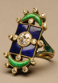 Marie Zimmerman. Ring of gold, enamel, diamonds, lapis lazuli and jadeite, nephrite or serpentine. Circa 1900.