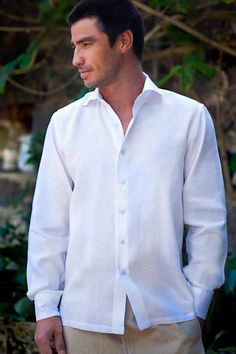 Simply Beautiful <3<3  Groom's Attire~White button down, with tan linen pants.
