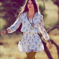 """Free People Wild Horses Dress Breezy, beautiful dress by Free People. Details: - V-neck - Long sleeves with elasticized hems - Ruffle trim - Banded waist with smocked detail - Pleated trim - Fully lined - Printed throughout - Approx. 35"""" length - Imported Free People Dresses Mini"""