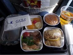 Skytrax rates the food at 1-star for economy and 2-star for business class. Most reviewers say that it's edible, but nothing special