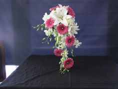 Cascading bouquet using fushia gerberas and dendrobium orchids. Find out more at www.freshnfabulousflowers.com