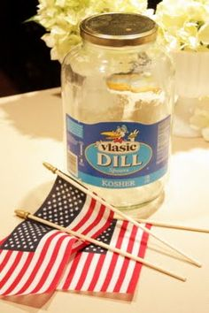 Modge podge flags (removed from the staffs) onto a clean jar for a patriotic hurricane, add sand and tea light inside. Try this with other fabric after 4th of July?