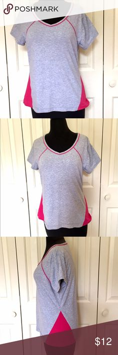 """Danskin Now Workout Pink/Gray Top • LARGE Danskin Now women's activewear V neck top.  This is a gray top with hot pink accents.  92% polyester 8% Spandex.  It measures 20"""" armpit to armpit.  It measures 25"""" down the center back.  No issues.  Non Smoking Home Danskin Now Tops Tees - Short Sleeve"""