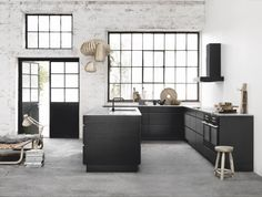Kitchens in black and white - not my usual all white swoon but I like the uncluttered look and the windows