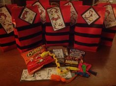 Calvin & Hobbes party favor gift bags!  Used red paper bags from the dollar store, added black electrical tape for Calvin stripes.  The tags were made with color copies of the comic pasted on to black poster board.