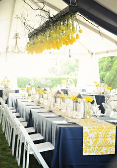 Black, white and yellow wedding decor. Coordinated by The Proper Setting / Florals and Decor by Renee Landry Style / Photographed by Neil GT Photography http://www.outerbanksweddingassoc.org/membersearch/memberpage.html?MID=1951=Equipment+Rentals=11 http://www.outerbanksweddingassoc.org/membersearch/memberpage.html?MID=1921=Florals=12 http://www.outerbanksweddingassoc.org/membersearch/memberpage.html?MID=1891=Photographers=16