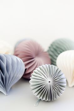 You don't have to wait till Christmas to hang up these beautiful origami paper ornaments!