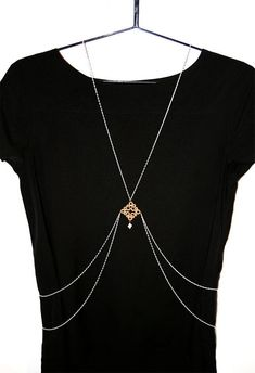 729566a6369ba Body chain with gold tatting lace pendant and small mother of pearl cross