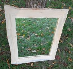 This Rustic Red Pine framed mirror with live edge brings the outdoors of Wisconsin indoors.  Naturally detailed with wormholes gives this frame a unique look that could easily be used as a bathroom mirror, hallway mirror, or as a nice addition to a cabin or cottage. This frame is rustic in nature meaning that there may be imperfections in the wood such as cracks or wormholes that give the frame that natural, rustic look but do not negatively impact the integrity of the frame in any way.