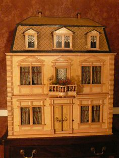 Christian Hacker's Dolls' House is in excellent condition with its original paint and wallpapers. The exterior is painted a soft golden colo...