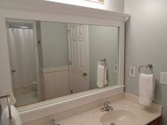 Like this idea to dress up a basic contractor mirror. Frame a Mirror.