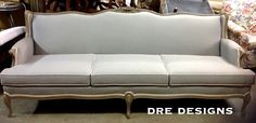 """Andrea Guerriero - DRE DESIGNS www.dredesigns.ca www.facebook.com/dredesigns.ca  Fabulous French Provincial sofa COMPLETELY re-designed top to bottom.  Painted using @Annie Compean Sloan French Linen, distressed, and both clear and dark waxes.  Re-upholstered using @j f Fabrics """"Snap"""" and """"Crackle"""" New foam everywhere, brand new piece!"""