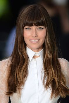 Jessica Biel latest hairstyle with blunt bangs and lighter ends