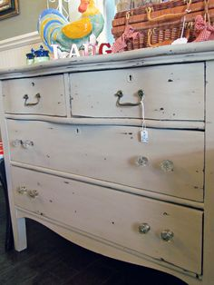 shabby chic dresser with mismatched handles and knobs