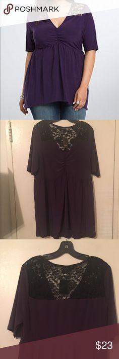 Torrid purple ss lace inset babydoll shirt 2 = 2X Torrid purple short sleeve shirt with black lace inset. This is a babydoll type shirt. Torrid size 2 conversion to 2X torrid Tops