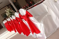 Chair bows and white covers for table and seats where the bride, groom and closest people sit.