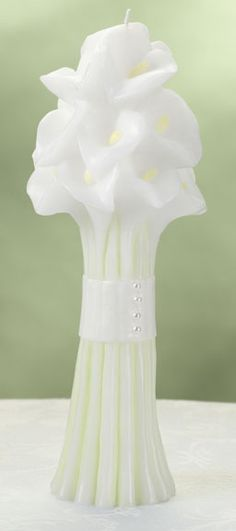 "Lillian Rose Calla Lily Bouquet Candle This beautiful 10"" tall pillar candle is colored wax in white, greens and yellows, all made to look like a bouquet of calla lily flowers. The base of the candle has a 2.625"" diameter. The widest point of the candle is 3.75"". Price $9.90"