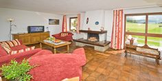 Living room with open fire place - Haus Jonghof Apartment 2&3 | Seefeld Apartments