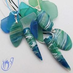 Faux agate polymer clay beads. The sea glass in the background really helps to draw out the colors in the beads.
