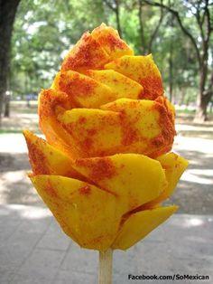 Mexican Mango! Inset a stick on a peeled mango and cut. Sprinke salt, lemon juice and chili powder. Yummm!