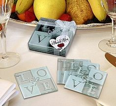 Tempered glass coasters measure 3 1/2 inches square by 3/16 inches thick and are sold in sets of 4 beautifully packaged in a clear box tied with a sheer satin bow and heart shaped thank you tag.