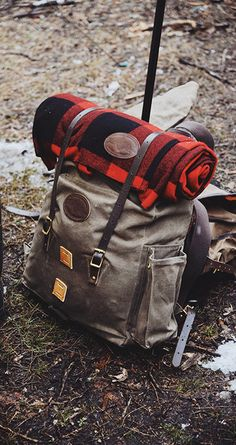 Frost River's wool blanket with a trusty pack on location in canoe country