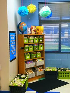 A wonderfully simple and organized classroom library. I'm not sure about small kids reaching the top shelves, but perhaps teacher read alouds can be placed in the higher spots. :) Jodi from www.CFClassroom.com