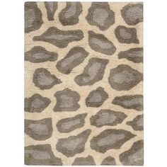 This Meadows shag rug features an exotic leopard print design with a soft and shaggy texture. Beige with black accents complement both contemporary and eclectic decor.
