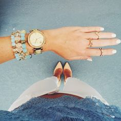 Blue and gold arm stack Instagram: @caitlincarol_