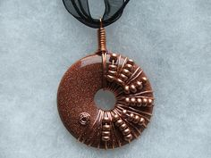 Wire wrapped donut pendant necklaces | Sally Cerro-Hughes | Flickr