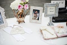 Vintage decor guestbook table with props from Vintage Ambiance | Photography: Melissa Shaw Photography | Read More: www.stylemepretty... #guestbook #vintagedecor #unquiecenterpieces