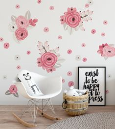 An arrangement of Pink and White Graphic flowers on a white wall