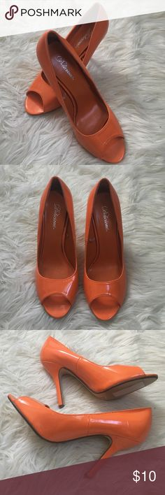 Orange open toe heels Bright orange open toe heels!  Perfect for Miami Dolphins or Chicago Bears fans!  Never worn outside an office and show no signs of wear. Small scuff on each of the heels (seen in pictures 3 and 4). Open to offers! Shoes Heels