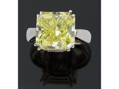 10.04 carat intense fancy yellow diamond ring, sold for $176,250.00