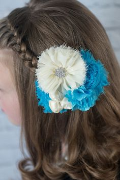 Ivory ballerina chiffon flower, turquoise shabby and blue mesh ivory rosettes on an alligator clip. La Bella Rose Boutique