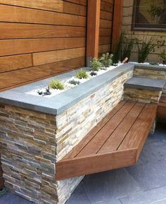 stacked stone planter box with wooden carpentry