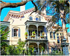 """This First Street Home in the New Orleans Garden District is always an eye catcher. The front is great but the side galleries are something else. This home was built in 1869 and is known as the Carroll-Brown House. Mostly Italianate in style with extensive wrought iron which was attached at a later date. We can call this a New Orleans """" grande maison""""."""