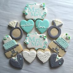 Aqua, grey, white, and silver wedding cookies. Tuxedo and wedding dress heart decorated cookies. Mr & mrs. engagement ring cookies. Created by Charlotte Gushue of Cookie Starts with C
