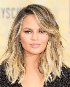 Chrissy Teigen's tousled lob seriously looks good on ANYONE - though it's hard to decide between all of these easy summer styles.
