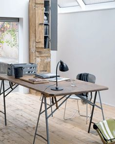 I like the look of the metal framed desk (made of pipes?) and the rustic cabinet (big one?)