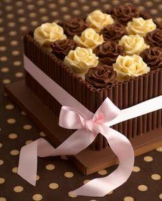 'Chocolate Box' birthday cake  : Chocolate fudge cake, Amedei Toscano    chocolate and orange zest, buttercream, Satab ribbon, milk   chocolate curls, handmade chocolate roses