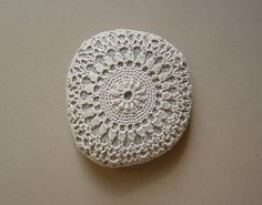 That's right, someone took cotton thread and crocheted a doily around a rock. American ingenuity really is astounding sometimes. I'm just trying to figure out what you would do with a doily-rock.